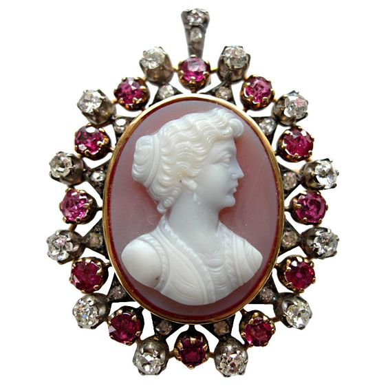Victorian Hardstone Cameo With Rubies and Diamonds  Unknown  Victorian  Beautiful hardstone cameo surrounded by 6 carats of rubies and 4 carats of diamonds. May be used as a pin or a pendant.