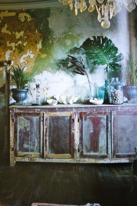 Incredible color and mystery.  Love the bare floor, giant green fronds, and ceiling sparkle!  Distressed wall is brave and beautiful.