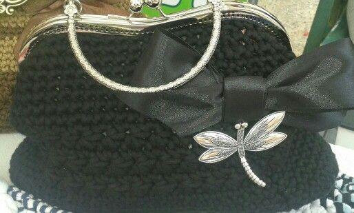 Bolso tejido en algodón con cierre modelo flor