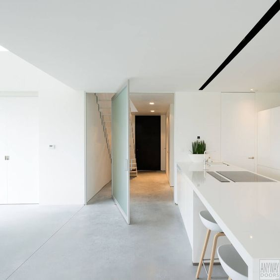 Innovative Pivoting Doors Double as Room Dividers - http://freshome.com/innovative-pivoting-doors/