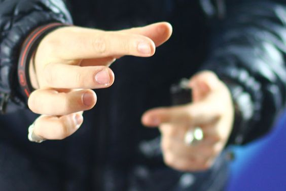 Magciian Josh Brett burns a heart onto his finger
