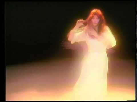 "Official music video for the single ""Wuthering Heights"" -- Version 1 by Kate Bush.     Wuthering Heights was released as Kate's debut single in January 1978. It became a No.1 hit in the UK singles chart and remains Kate's biggest-selling single.     Two music videos were created to accompany the single. In Version 1, Kate can be seen performing the song in a dark room filled with white mist while wearing a white dress -- this was the UK release. In Version 2 Kate dances in an outdoor…"