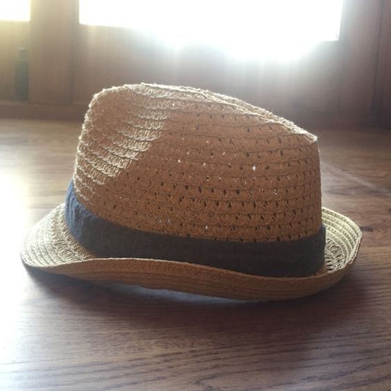 Straw fedora with blue accent bow Target hat that is straw colored with a blue ribbon and bow around the middle of the hat, worn once Target Accessories Hats