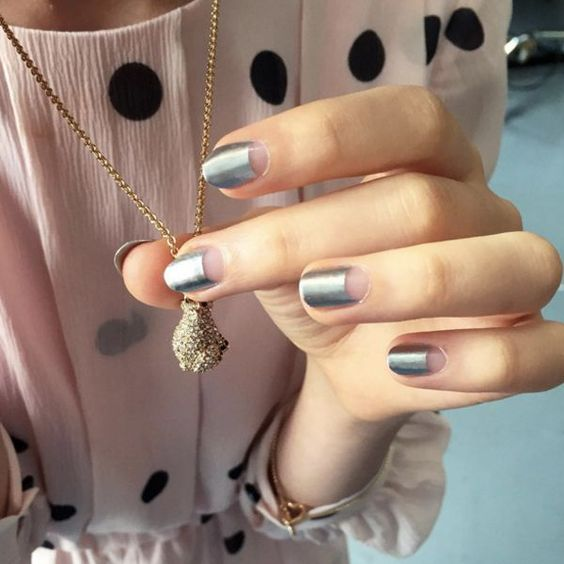 """18 Manicures To Copy, Stat! #refinery29 http://www.refinery29.com/negative-space-nails#slide-14 """"When you want a simple mani, but you also don't want a simple mani, this is the one,"""" says Torello. """"A pretty half-moon is forever classy, and you can do a metallic to spice it up for the holidays. For a simple way to get the moon shape, use a reinforc..."""