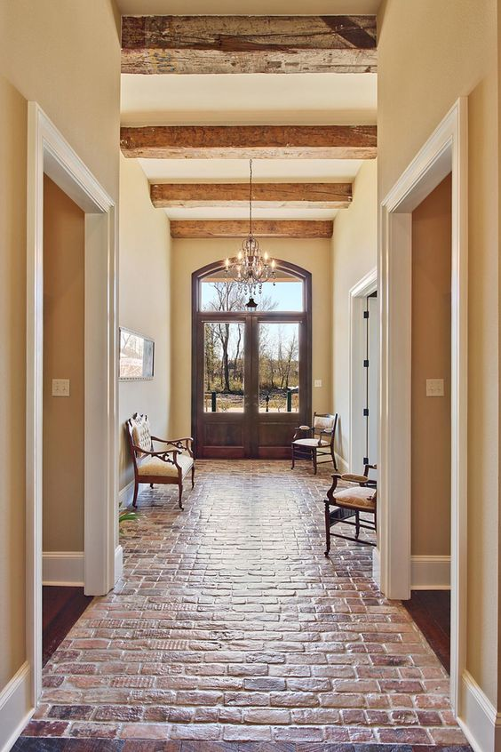 Beautiful entance hallway brick floor troyer builders for Entrance foyer tiles