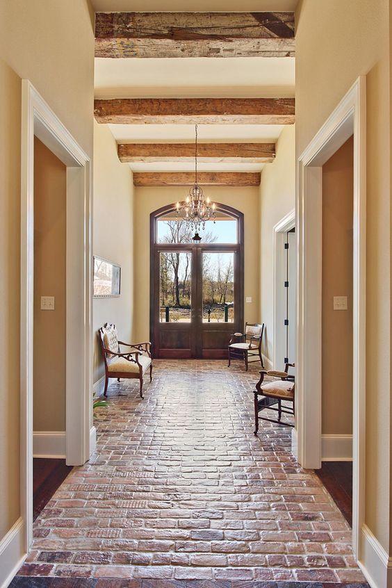 beautiful entance & hallway, brick floor ~ Troyer Builders