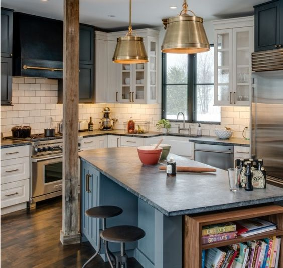 This kitchen has a little bit of everything but it seems to tie in pretty well. The pale soapstone over white and blue cupboards and the black and white over the top all seem to match somehow and create a fun but eclectic look.