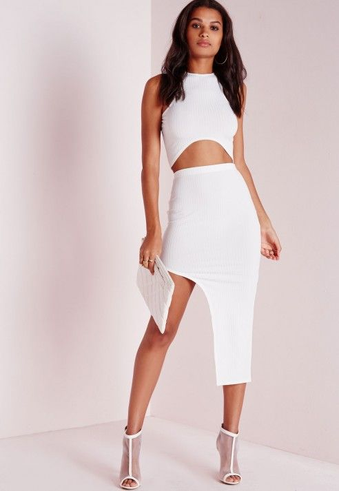 Work this midi to the MAX this weekend. In an extreme asymmetric style this white basic ribbed skirt is a new must have. In stretch jersey this skirt will hug your curves and give you a bodycon-tagious look and feel. Team with the matching ...