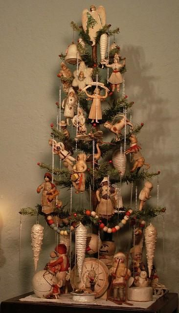 Small Christmas tree decorated with vintage wooden ornaments