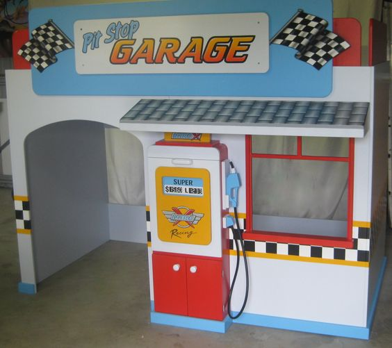 Awesome boys Garage playhouse loft bed by KidSpace Playrooms!