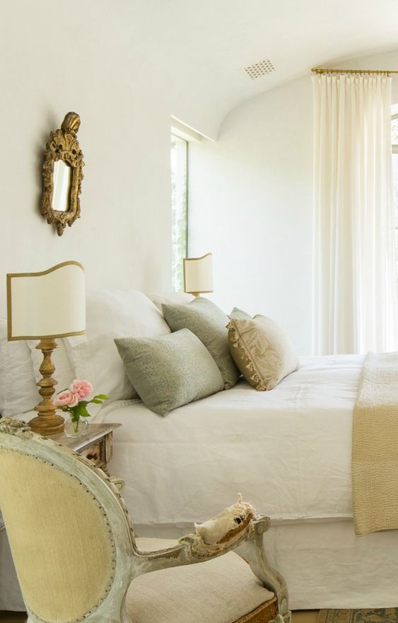 MODERN FARMHOUSE BEDROOM with French Country interior design inspiration from truly a house beautiful. A neutral French Country bedroom with aqua accents at Patina Farm, a serene modern farmhouse by Giannetti Home. The romantic decor, antiques, and bespoke furniture combine for a sophisticated, timeless, and tranquil result. #modernfarmhouse #frenchcountry #interiordesignideas #serene #patinafarm #farmhousestyle #eurpeancountry #antiques #interiordecorating #bedroomdecor