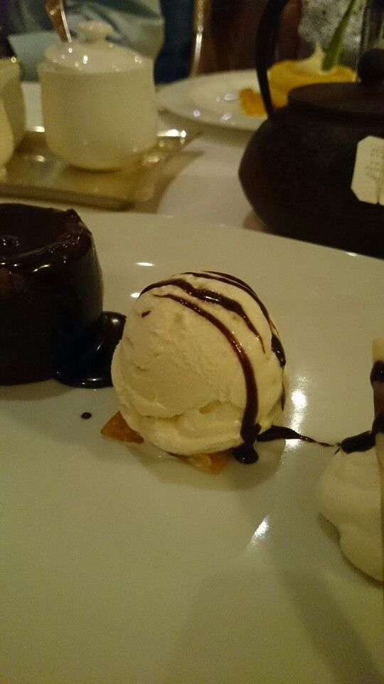 Dark chocolate cake with ice cream.