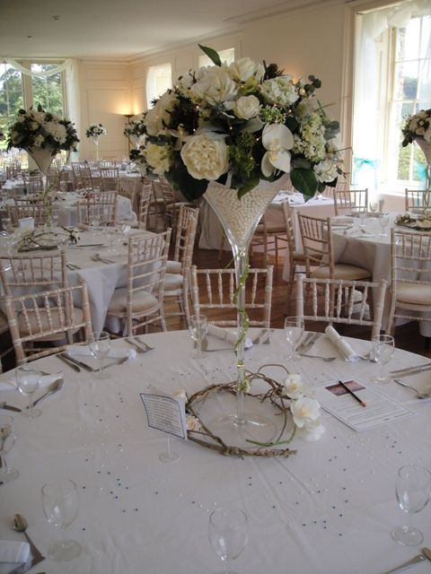 Ivory wedding flower centrepiece. Martini vase and silk flowers to hire - bespoke design by Flourish
