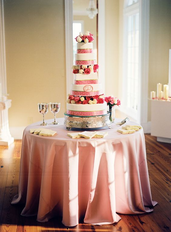 Pink and white tall cake.