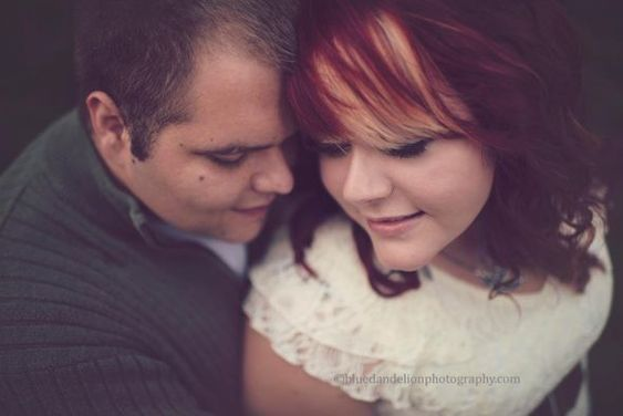 Nice pose for plus sized Bride and Groom engagement photos
