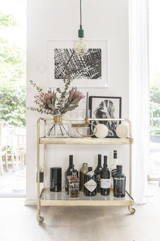 Think about creating a story with your art in the kitchen. It's a personal place, so why not reflect that through your art? A nice drinks cart or server will do the trick. #trend #kitchendesign