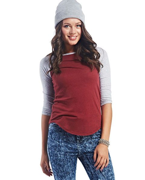"<p>Get back to basics in this sporty-inspired soft knit raglan baseball tee featuring a light heather knit on the bodice and colored heather knit 3/4 raglan sleeves. Top also has a scoop neckline trimmed in a sleeve-matching heather knit and a rounded hem. Unlined.</p>  <p>Model is 5'9"" and wears size small.</p>  <ul> 	<li>57% Cotton / 43% Polyester</li> 	<li>Machine Wash</li> 	<li>Imported</li> </ul>"