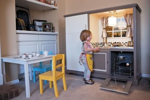 Look at this awesome play kitchen, made out of an old wooden entertainment center. It was featured in Time Out Chicago Kids. Now will someone figure out what to do with old drop-side cribs?