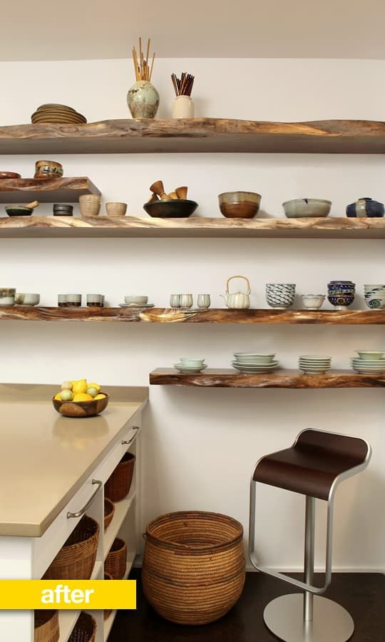 """We were recently sent photos of a lovely kitchen renovation on New York's Upper West Side.The husband and wife — a retired couple on a budget — wanted a new kitchen to accommodate their love for cooking and enable them to display a few treasured heirloom pottery pieces. They also wanted to find a prettier way to deal with """"their habit of leaving things out in the open."""" The result is a soothing, neutral color palette, four stunning (and heavy) shelves, and a place to put everything!"""