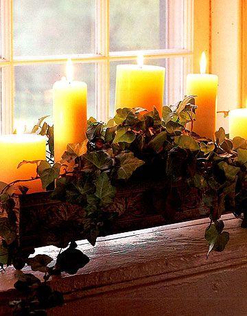 pillar candles in window box