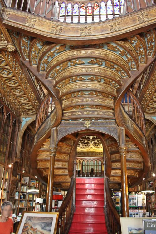 Delicious Art Nouveau design curved lines in this 1906 bookstore in Porto, Portugal