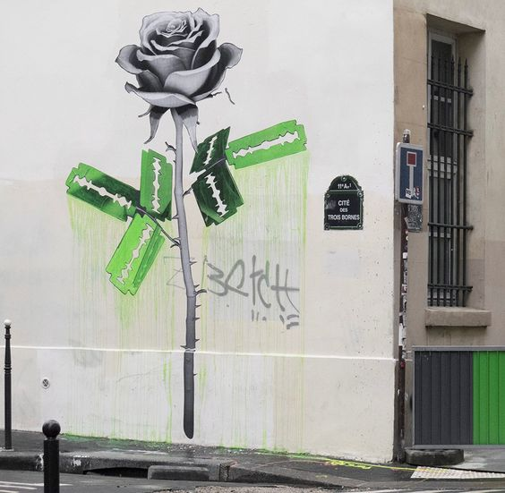 Working primarily with Grey scale and green, the French artist brought to life some large and impressive artworks.  As usual with Ludo, his works are striking when you encounter them in person. We especially enjoyed seeing the Razor blade rose in Paris, France, which has to be one of our favorite recent pieces from Ludo.  #streetart #artworks #murals #ludo #Paris #France #allpublicart #wallart #streetartist