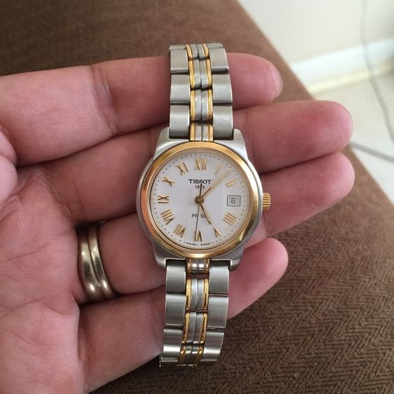 Authentic Tissot 1853 PR50 Ladies Watch Authentic Tissot 1853 PR50 Ladies Watch, stainless steel and gold plated bracelet, sapphire crystal crown. Pre-owned in great condition, no box available. Tissot Accessories Watches