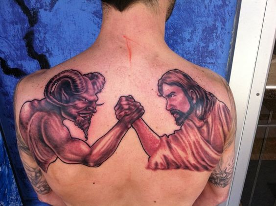 Devil and jesus arm wrestling tattoo tattoos pinterest for Jesus tattoos on arm