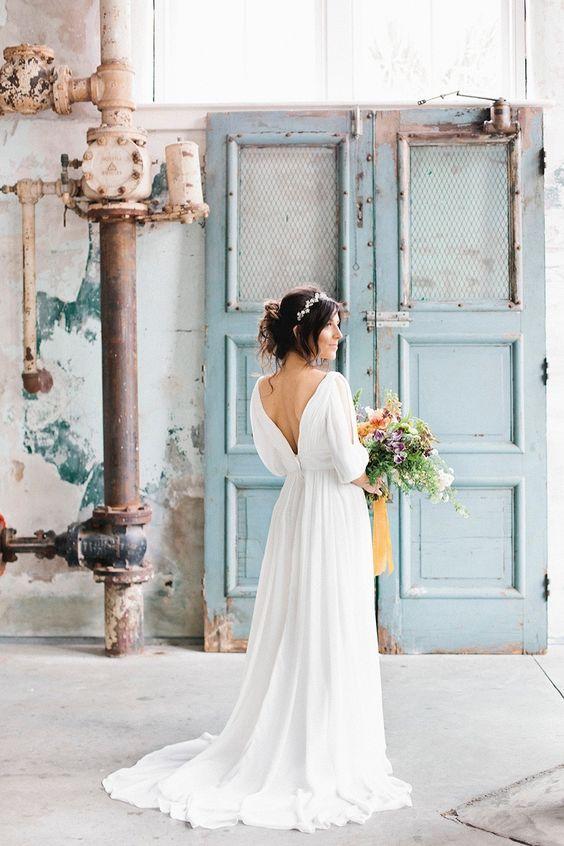 Draped, free flowing wedding dress: http://www.stylemepretty.com/2016/02/17/modern-wedding-dresses/