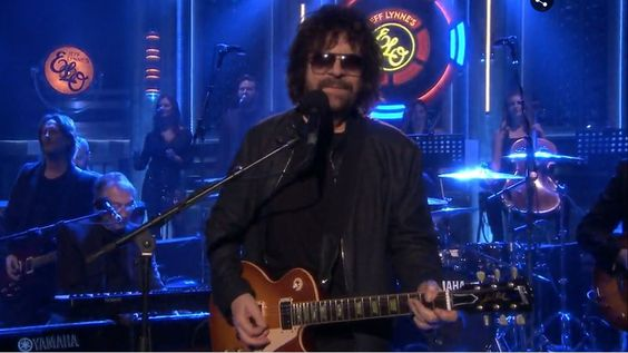 "Watch Jeff Lynne's ELO Revive Rousing 'Mr. Blue Sky' on 'Fallon' --Electric Light Orchestra singer also performs nostalgic ballad, ""When I a Boy,"" from new album, 'Alone In the Universe':"
