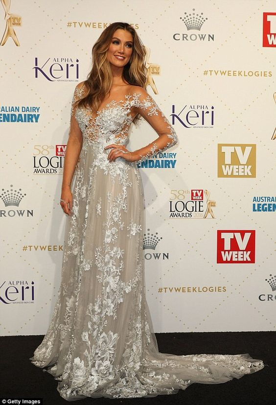 A look like no other! Delta Goodrem stunned in a bridal-inspired Paolo Sebastian gown on Sunday night as she strutted down the TV Week Logie Awards red carpet at Melbourne's Crown Palladium