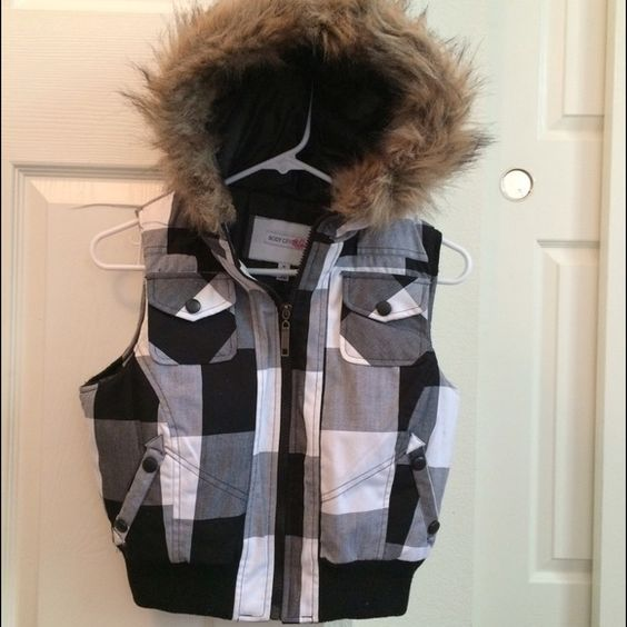 Vest with Faux Fur Lined Hood NWOT! Can also fit a small. Black, white, and gray vest with faux brown/black fur lined around the hood. Always open to offers and I discount bundles Body Central Jackets & Coats