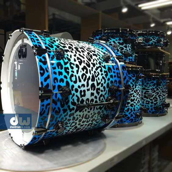 Maple/Mahogany kit. Cheetah Print all over, this kit is built for speed! #dwcustom #thedrummerschoice #dwdrums