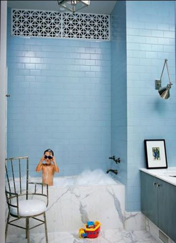 blue subway, Kelly Weastler. marble floor and tub surround. bathroom arm sconce