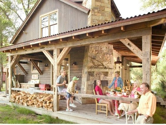 corrugated metal roof on the porch - must-have for the dream home.  rustic  by Coburn Development