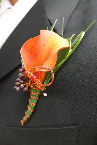 orange calla lily wedding flower boutonniere, groom boutonniere, groom flowers, add pic source on comment and we will update it. www.myfloweraffair.com can create this beautiful wedding flower look.