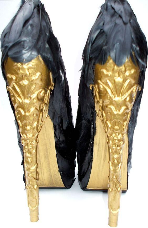 Alexander McQueen feather pumps with a gold brocade heel.
