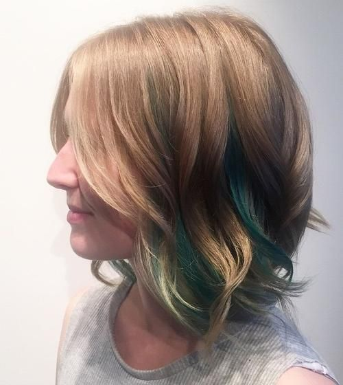 Long wavy bob with soft layers and highlights.