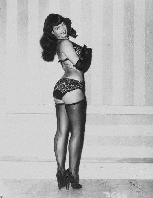 Betty Page Photos: Bettie Page, Clothes Sale And Thigh High Stockings On