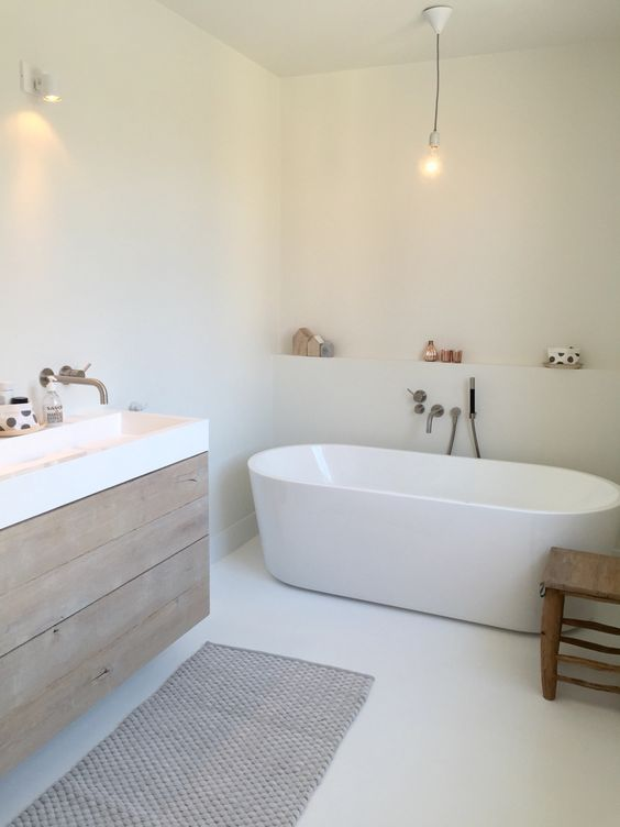 Love the vanity, would also add a feature tile on the top half of the wall where the beautiful bath is. Also needs more styling on the shelf...
