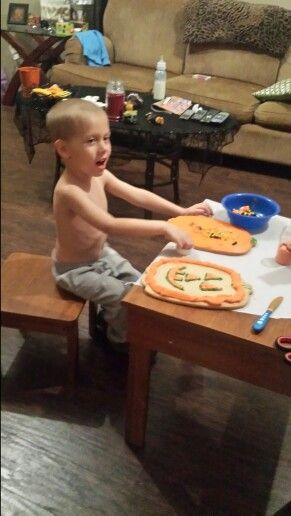 Making his big Halloween cookies