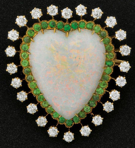 EDWARDIAN OPAL HEART BROOCH WITH DIAMONDS AND DEMANTOID GARNETS The shaped opal, 24 mm x 20 mm, defracting the spectrum from blue through red, is framed by a line of thirty-eight faceted demantoid and twenty-four OEC diamonds, approx 1.5 cts. TW, 14k,  : Lot 1177: