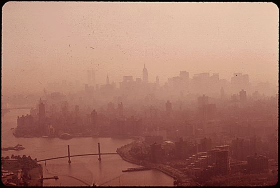 Manhattan skyline enveloped in heavy smog, May 1973: Chester Higgins/NARA. via Mother Jones