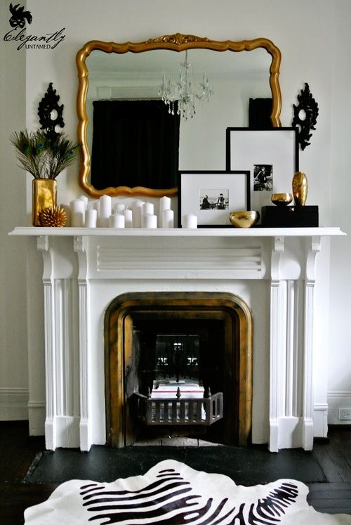Gold mirror fireplace mantel white candles framed photographs black white and gold - Black and white fireplace ...