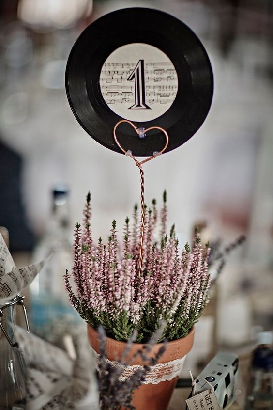We're loving these record table numbers! Such a great wedding DIY for music lovers!: