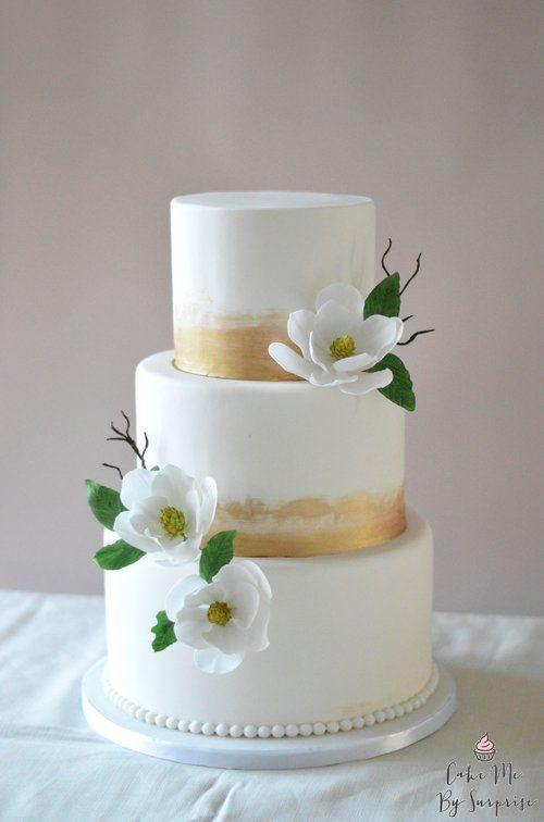 Brushed Gold Simple White Magnolia Wedding Cake Stunning Cakes Made By This Kent Bakery Cake Me By Wedding Cake Bakery Simple Wedding Cake Gold Wedding Cake