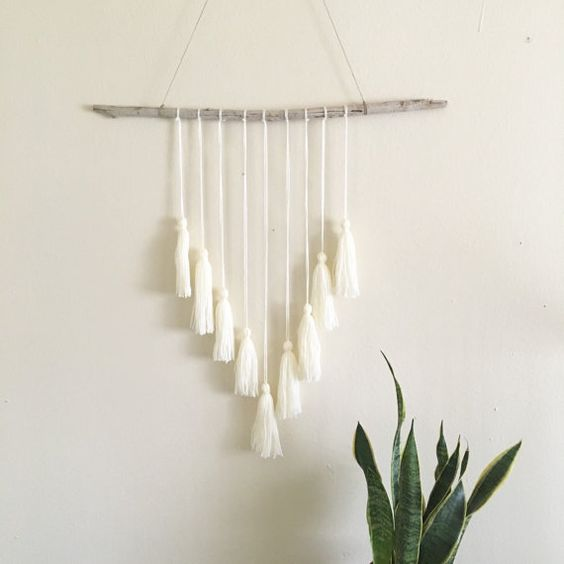 Details: Reclaimed driftwood wall hanging with cream yarn tassels and hemp twine to hang. Measurements: Wood piece is approx. 23 inches across and: