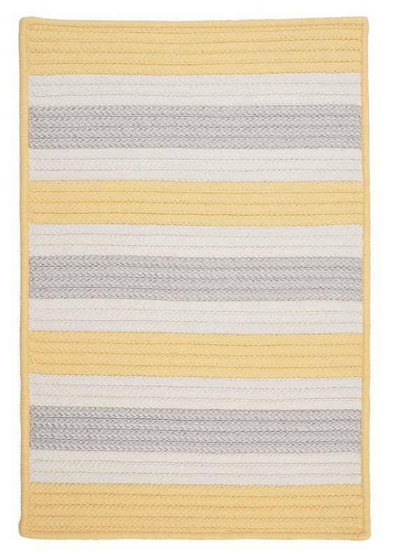 Soft yellow and silver stripes make up this fabulous 100% polypropylene braided beach house rug. Stain resistant and fade resistant, making these perfect accent rugs for poolside or for any coastal home space. Stripe It Rug - Yellow Shimmer
