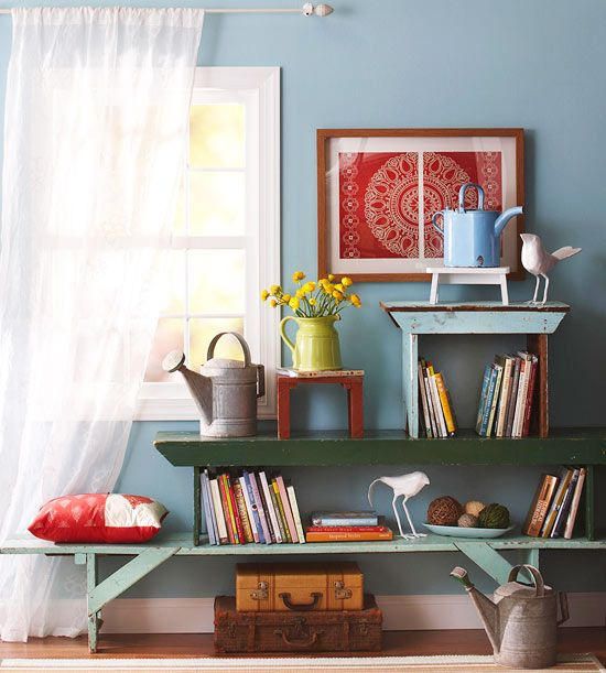 A series of antique benches becomes a charming shelving system. More flea market storage: http://www.bhg.com/decorating/storage/projects/from-flea-market-finds-to-savvy-storage/?socsrc=bhgpin071212stackedbenchstorage#page=2