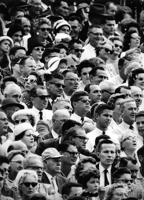 """""""A face in the crowd"""", President-elect John F. Kennedy attends the Orange Bowl game, January 2, 1961, by Flip Schulke."""